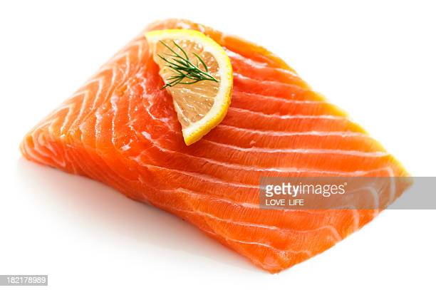 Fresh salmon fillet with a lemon and dill garnish