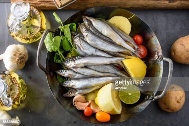 fresh sardines in wok - sardine stock pictures, royalty-free photos & images