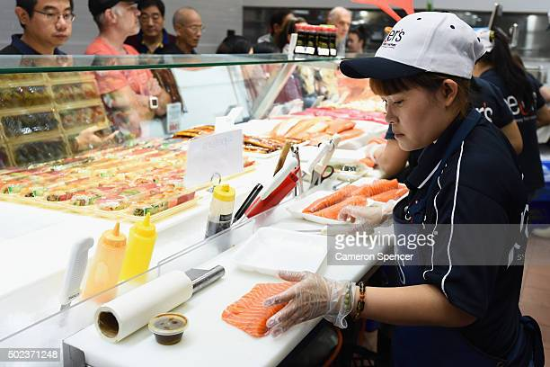 Fresh sashimi is prepared at the Sydney Fish Market on December 24 2015 in Sydney Australia The Sydney Fish Markets experience its busiest trade over...