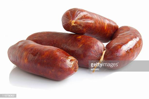 fresh sausage isolated on white - chorizo stock pictures, royalty-free photos & images