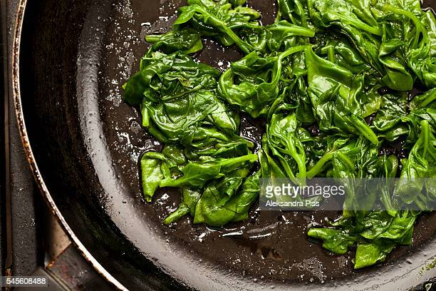 fresh sauted spinach on a pan - spinach stock pictures, royalty-free photos & images