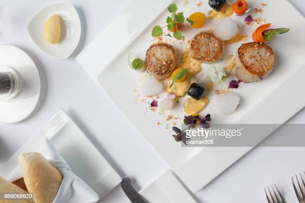 fresh scallop cooking with french style on light and relax table - seared stock photos and pictures