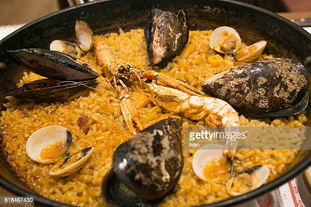 Fresh Seafood Paella in Traditional Cast Iron Pan
