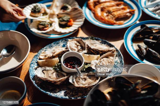 fresh seafood served on the dining table in restaurant - luxury stock pictures, royalty-free photos & images