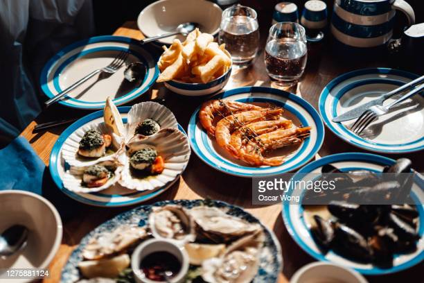 fresh seafood served on the dining table in restaurant - french food stock pictures, royalty-free photos & images