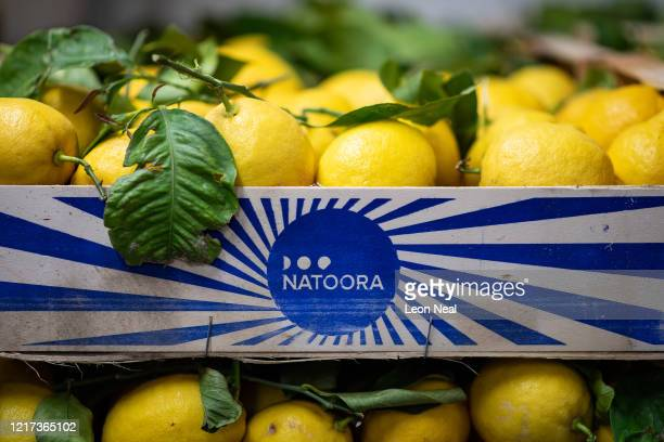 Fresh Sicilian lemons are seen in crates as employees of the highend fresh food wholesaler Natoora pick orders for home deliveries after the company...