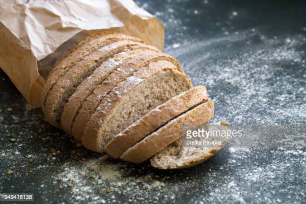 fresh sliced whole grain loaf of bread - loaf of bread stock pictures, royalty-free photos & images