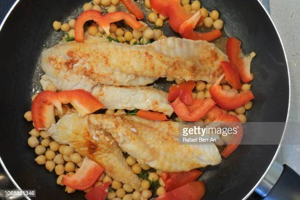 Fresh Slices of Fish Cooked in a Frying Pan