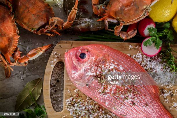 fresh snapper with salt and spices - redfish stock photos and pictures