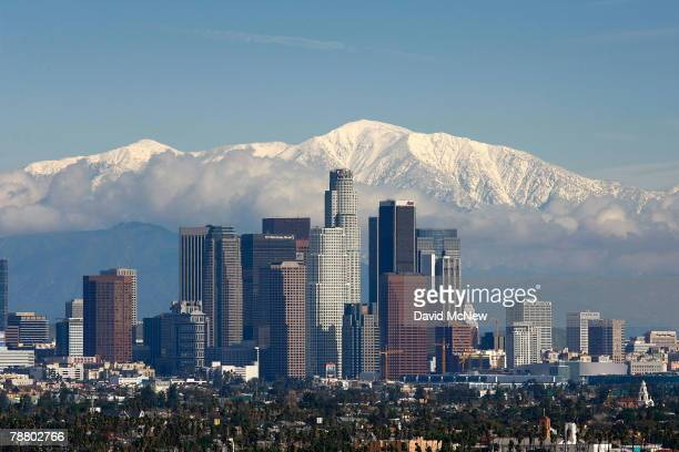 Fresh snow blankets the mountains behind the downtown skyline after a series of storms that hammered northern California delivered much needed...