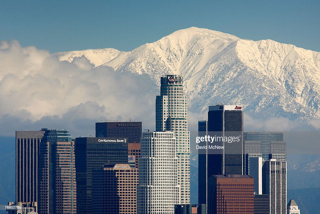 Fresh snow blankets the mountains behind the downtown skyline after a series of storms that hammered northern California delivered much needed precipitation to the Greater Los Angeles Area January 7, 2008 in Los Angeles, California. With the threat of mandatory water rationing still in effect because of prolonged drought, the rain is a small step toward relief. Forecasters had predicted flash floods and mudslides near large areas that were denuded by wildfires of historic proportions in October, and some mandatory evacuations were declared, but little damage was reported.