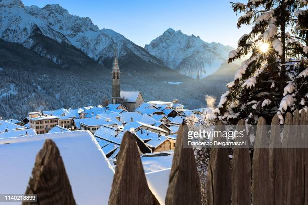 fresh snow in the village of sent, lower engadine, canton of grisons, switzerland, europe. - kanton graubünden stock-fotos und bilder