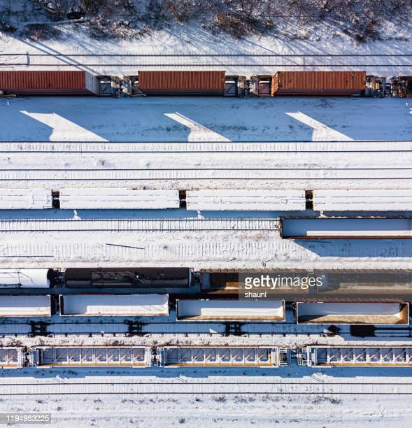 fresh snow on railyard - northern rail stock pictures, royalty-free photos & images