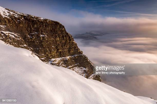 Fresh snow with cliffs at sunrise in the English Peak District. UK.