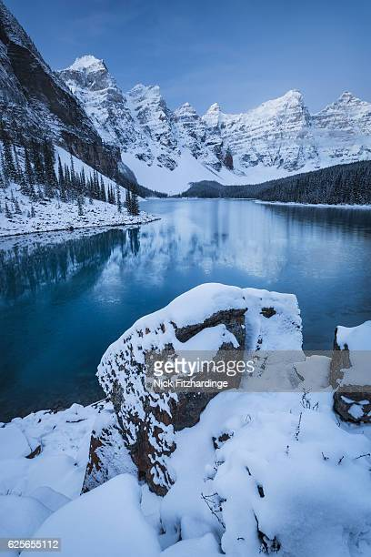 Fresh snowfall on the mountains surrounding Moraine Lake, Banff National Park, Alberta, Canada