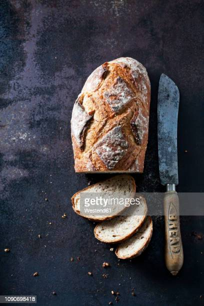 fresh sourdough brown bread - loaf of bread stock pictures, royalty-free photos & images