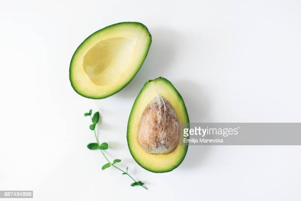 Fresh split Avocado on white background