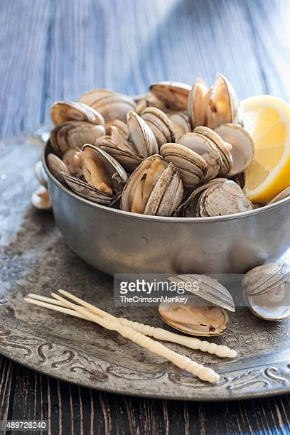 fresh steamed clams - clams stock photos and pictures
