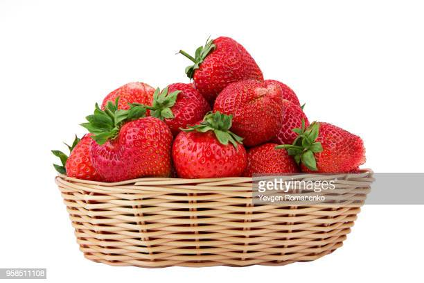 fresh strawberry in wooden wicker isolated on white background - cestino foto e immagini stock