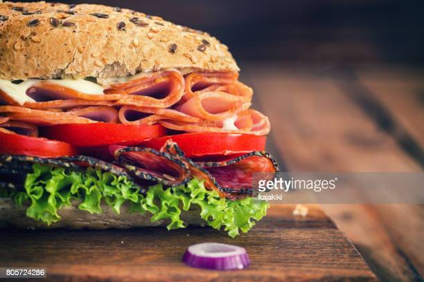 fresh submarine sandwich - delicatessen stock pictures, royalty-free photos & images