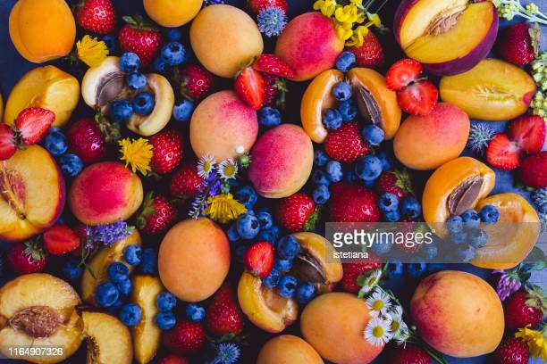 fresh summer colorful fruits and berries, top view - peach flower stockfoto's en -beelden