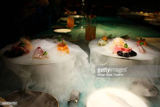 fresh sushi served on dry ice - dry ice stock pictures, royalty-free photos & images
