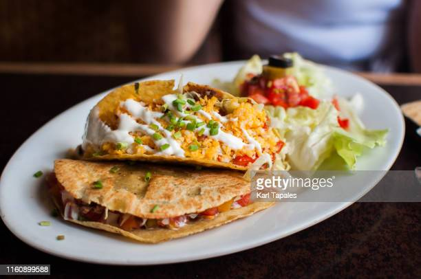 fresh tacos on a dining table - capital region stock pictures, royalty-free photos & images