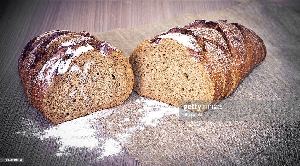 Fresh Tasty Bread on Woody Background : Stock Photo