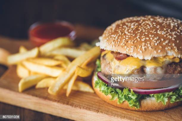 fresh tasty burger - cheeseburger stock pictures, royalty-free photos & images