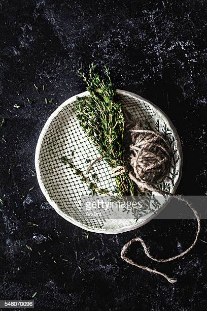 Fresh thyme on slate background