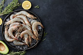 Fresh tiger prawns in a plate with ice