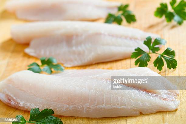 fresh tilapia filets - fillet stock pictures, royalty-free photos & images