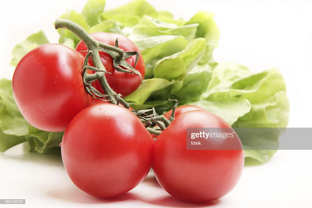 Fresh tomatoes and lettuce : Stock Photo