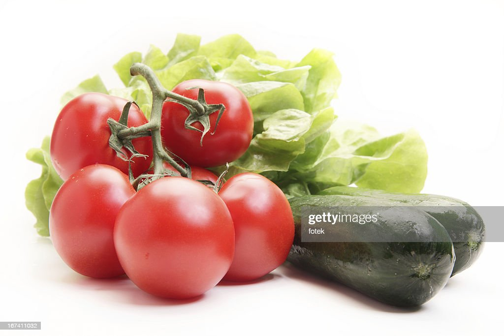 Fresh tomatoes, cucumber and lettuce : Stock Photo