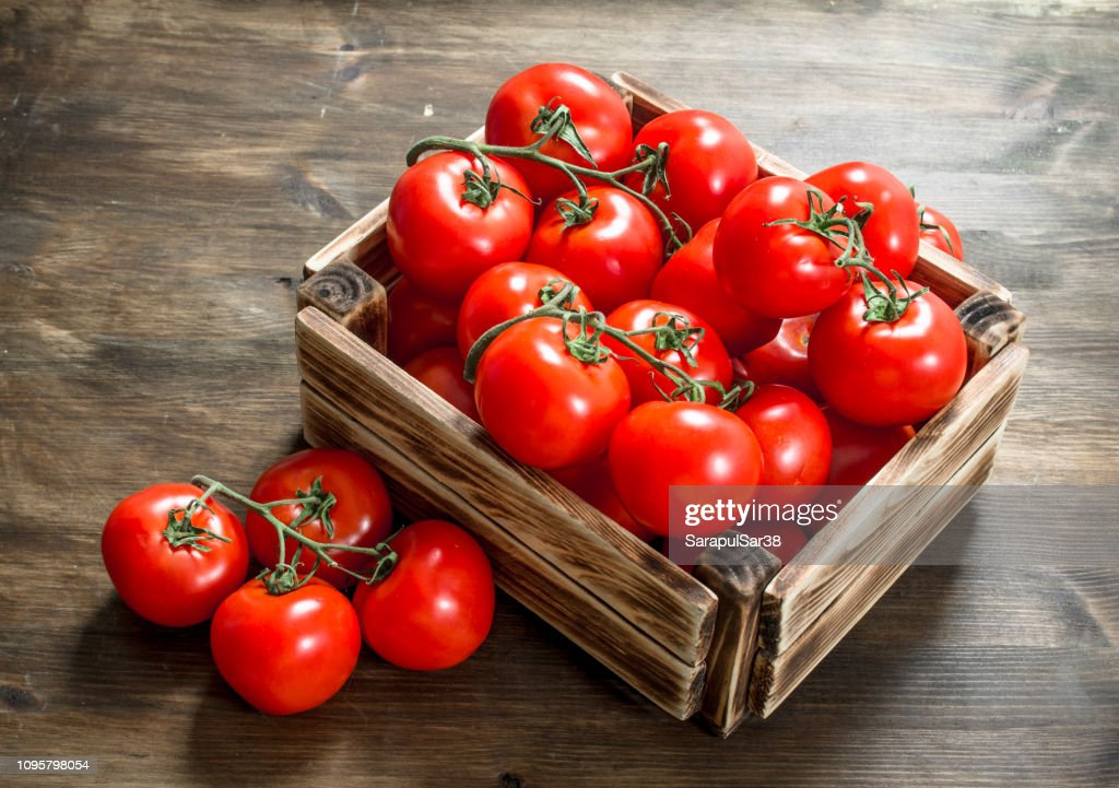 Fresh tomatoes in a box. : Stock Photo