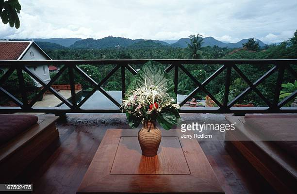 Fresh tropical flower arrangements grace the rooms of the PanSea Luang Prabang hotel The hotel sits on a hillside overlooking the valley in which the...