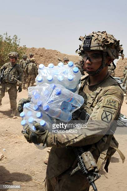 Fresh US troops from the 3rd Platoon Charlie Company 287 Infantry 3rd Brigade Combat Team arrive with supplies at a patrol base on the outskirts of...