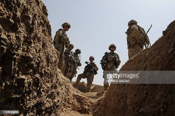Fresh US troops from the 3rd Platoon Charlie Company 287 Infantry 3rd Brigade Combat Team arrive at a patrol base on the outskirts of Kandalay...