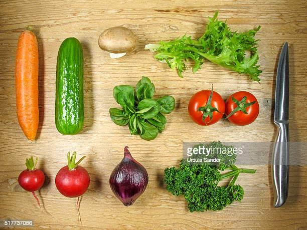 Fresh vegetable arranged on wooden chopping board