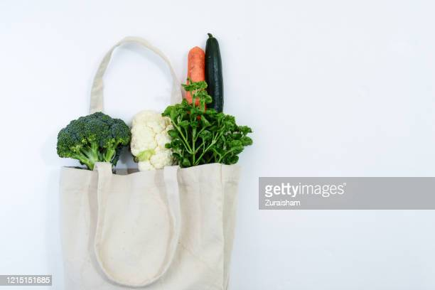 fresh vegetables and cotton canvas reusable shopping bag - bag stock pictures, royalty-free photos & images