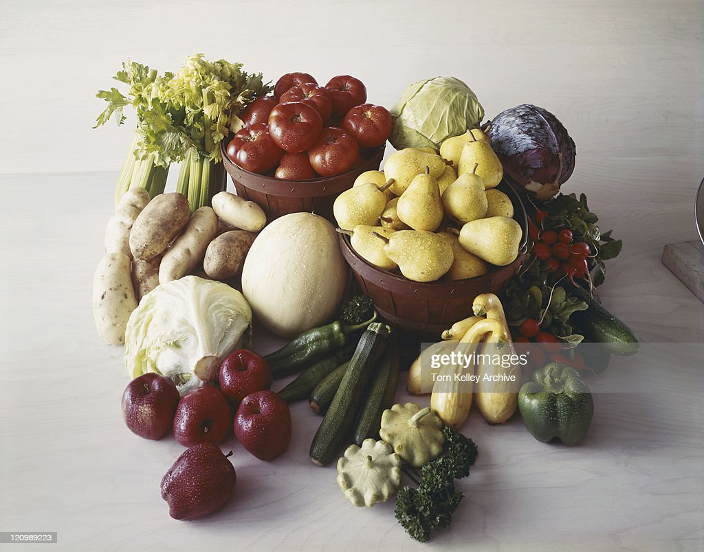 Fresh vegetables and fruit on wood grain : Stock Photo