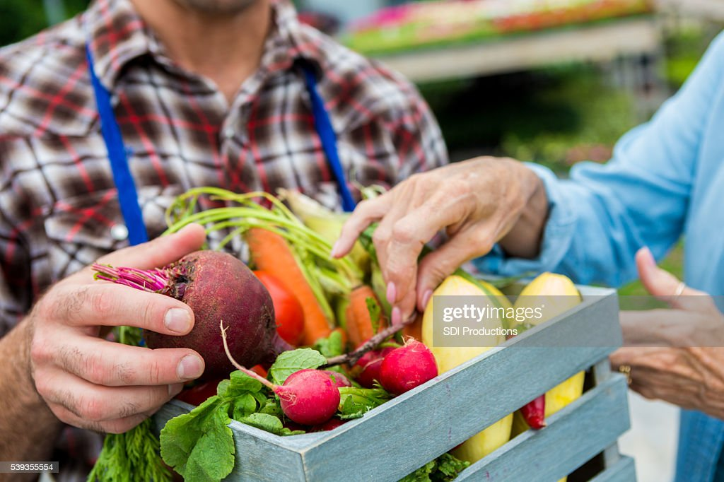 Fresh vegetables being sold at farmers market : Stock Photo