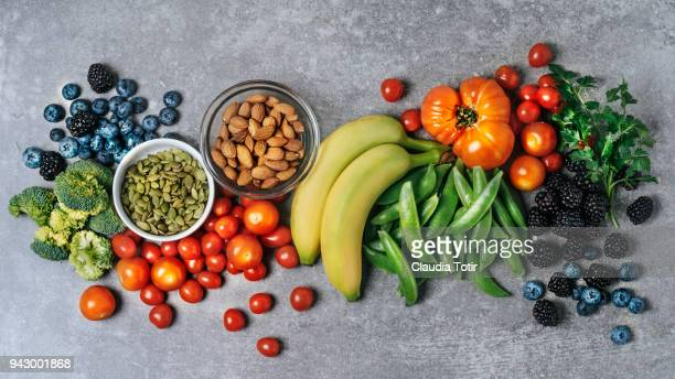 fresh vegetables, fruits, and nuts - dranken en maaltijden stockfoto's en -beelden