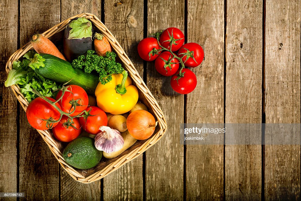 ... Fresh Vegetables In A Basket On A Wooden Table ...