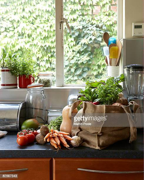 fresh vegetables in canvas bag on kitchen counter