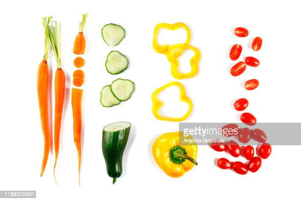 fresh vegetables isolated on white background. carrot, cucumber, pepper and tomato. flat lay. - cucumber stock pictures, royalty-free photos & images