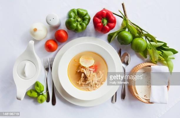 Fresh vegetables next to sopa de lima