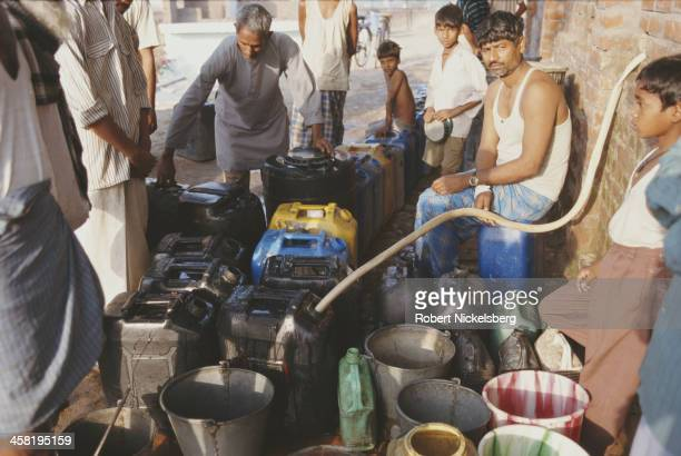 Fresh water being delivered India circa 1995