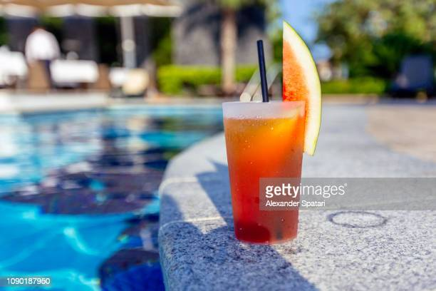 fresh watermelon cocktail by the swimming pool at tourist resort hotel - poolside stock pictures, royalty-free photos & images