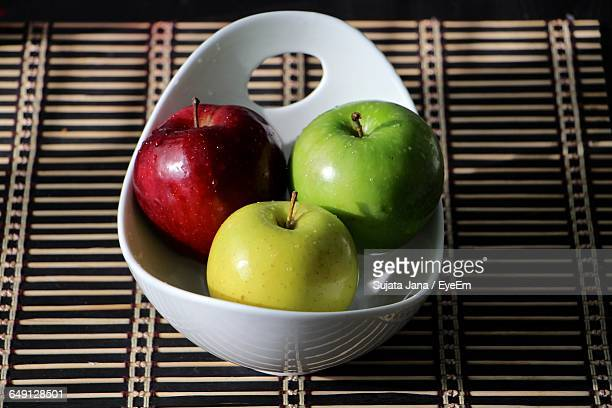 fresh wet apples in bowl on table - small group of objects stock pictures, royalty-free photos & images